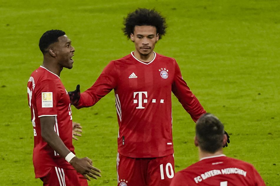 David Alaba (l.) und seine Kollegen vom FC Bayern München taten sich gegen den 1. FSV Mainz 05 lange schwer - einen Sieg gab es dennoch.