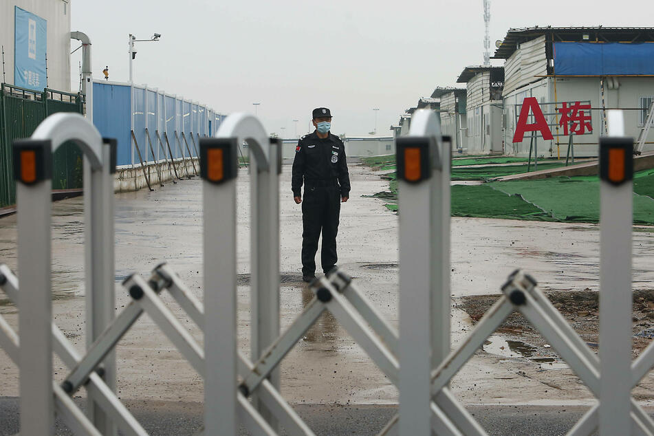 Security guard is posted at a gate sealing off the temporary Leishengshan hospital built in ten days to treat coronavirus patients in Wuhan.