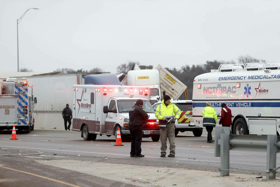 First responders at the scene of a massive pile-up of cars on I-35W northbound near downtown Fort Worth.