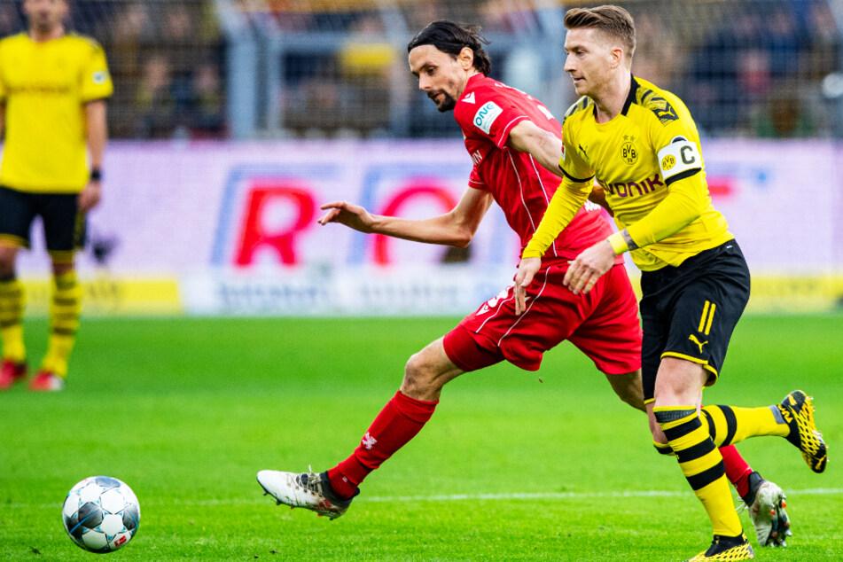 Neven Subotic (32, v.-l.) spielte am 1. Februar 2020 für den 1. FC Union Berlin in Dortmund um Kapitän Marco Reus (31). Zwar verloren die Eisernen mit 0:5, doch der Innenverteidiger wurde anschließend groß von den Fans gefeiert.
