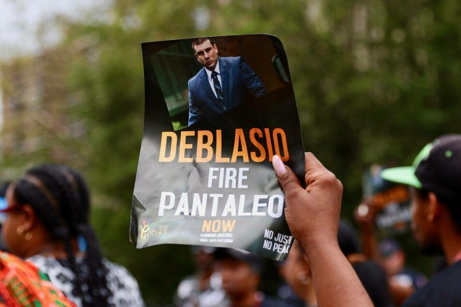 A protester outside of NYPD headquarters in 2019, calling for the firing of then-officer Daniel Pantaleo.