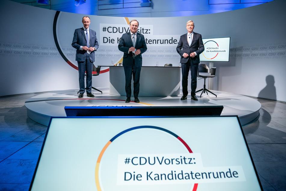 Die drei Kandidaten für den CDU-Parteivorsitz Friedrich Merz (65, l), Armin Laschet (59, M) und Norbert Röttgen (55).