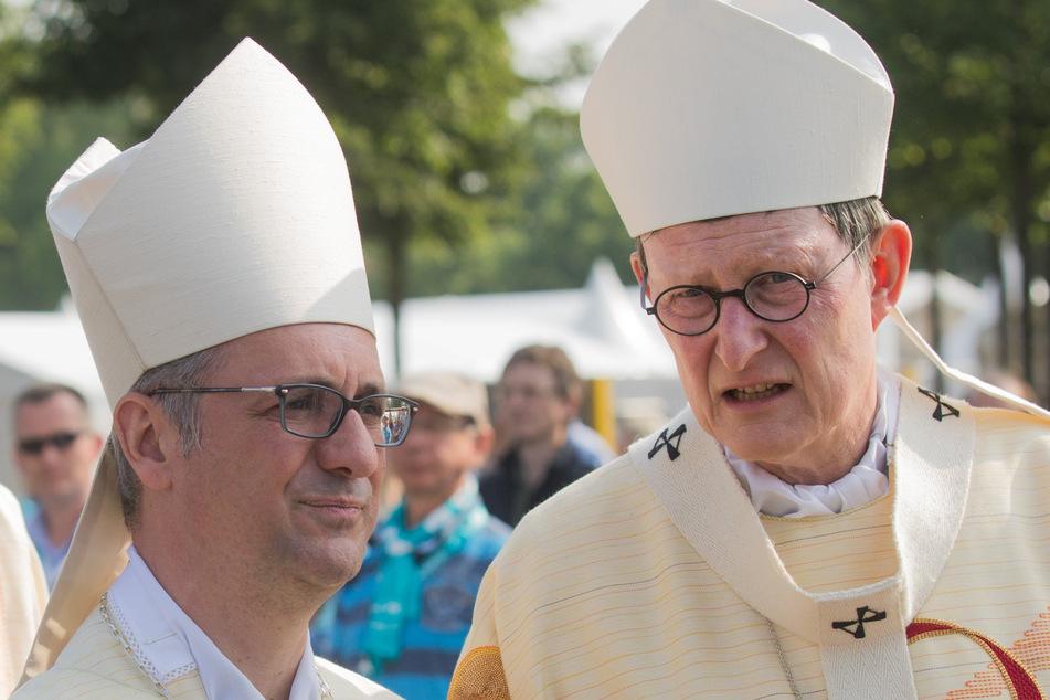 Der Fall wurde auf Anordnung von Kardinal Rainer Maria Woelki (64, r.) erneut aufgerollt. Erzbischof Stefan Heße (54, l.) ist wegen des Verdachts der Vertuschung in Bedrängnis geraten.