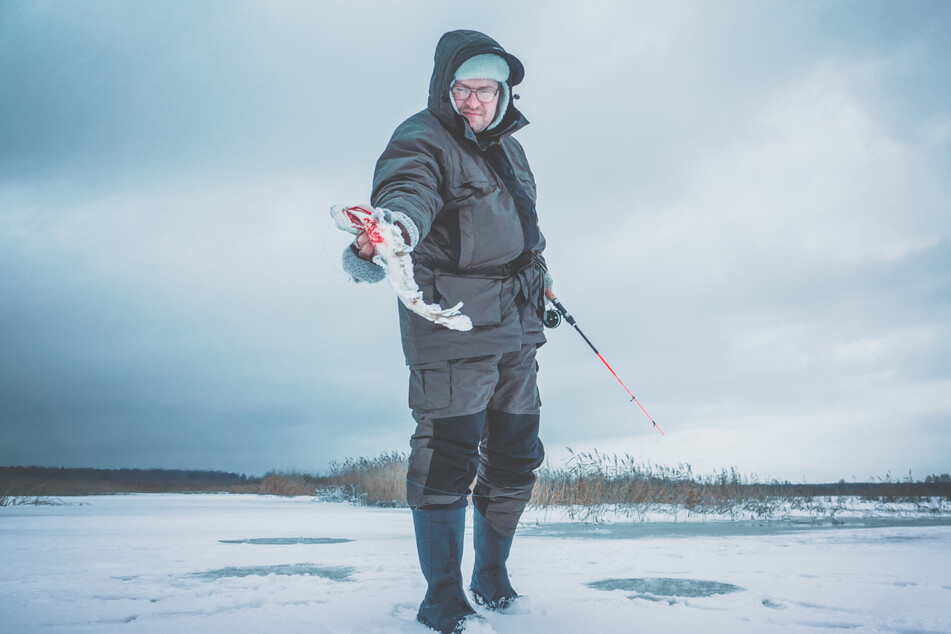 Ice fishers need to be careful where they put their phones while angling (stock image).