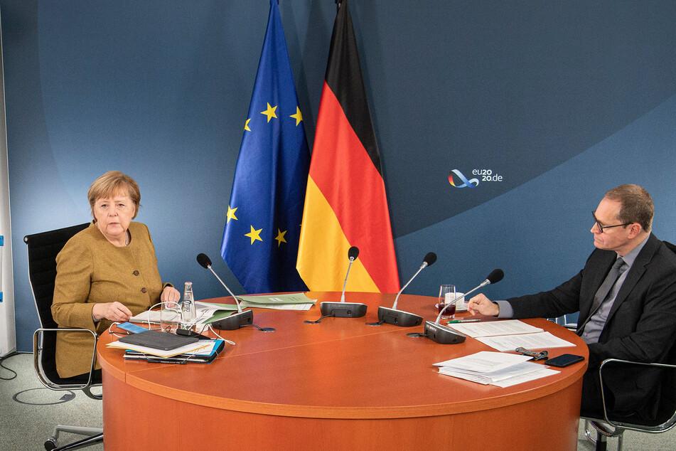 Bundeskanzlerin Angela Merkel (CDU) und der Regierende Bürgermeister von Berlin, Michael Müller (SPD).