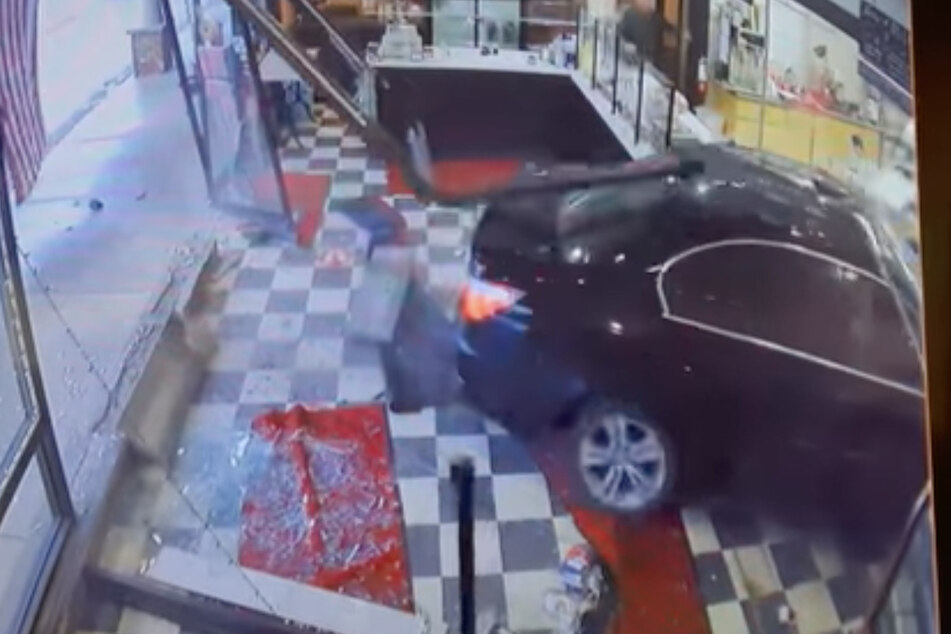 Braking bad: footage shows woman crashing her car into NYC bakery