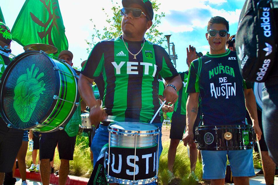 La Murga de Austin performs outside Q2 Stadium as they await the arrival of Austin FC players.