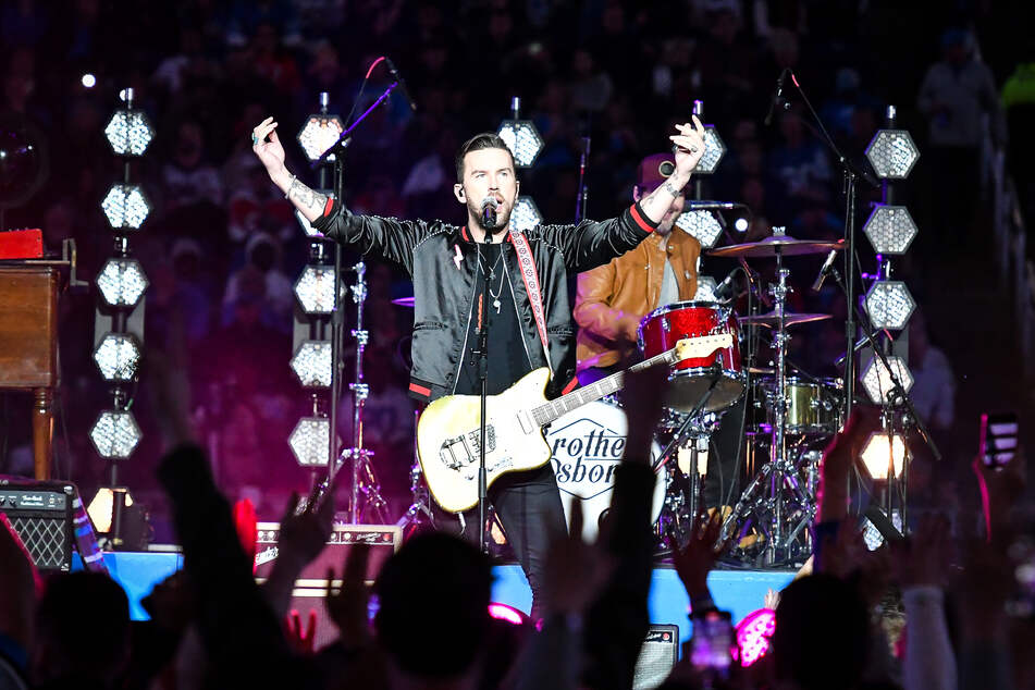 TJ Osborne of The Brothers Osborne performing during a 2019 NFL game in Detroit.