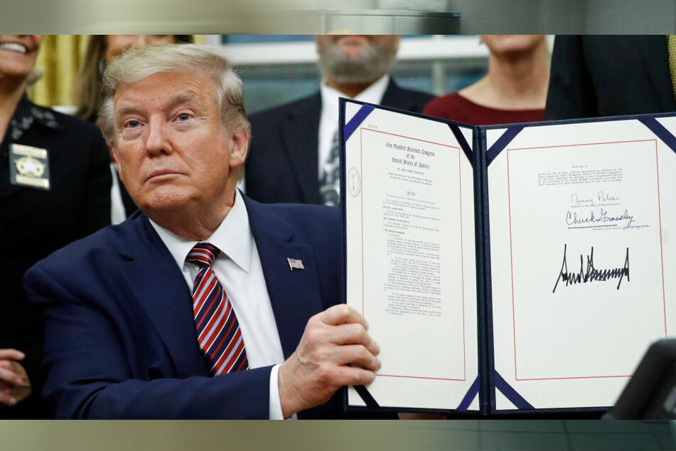 Donald Trump (74) presenting the signed animal cruelty act at the White House in November 2019.