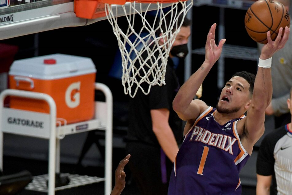 NBA: Suns beat the Bucks in overtime as Devin Booker holds his nerve in the final seconds