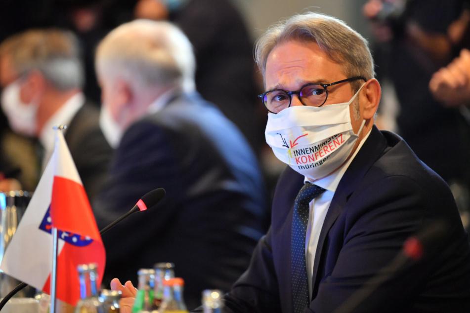 Thüringens Innenminister Georg Maier (53, SPD), sitzt am Tisch in der Plenarsitzung während der Innenministerkonferenz (IMK).