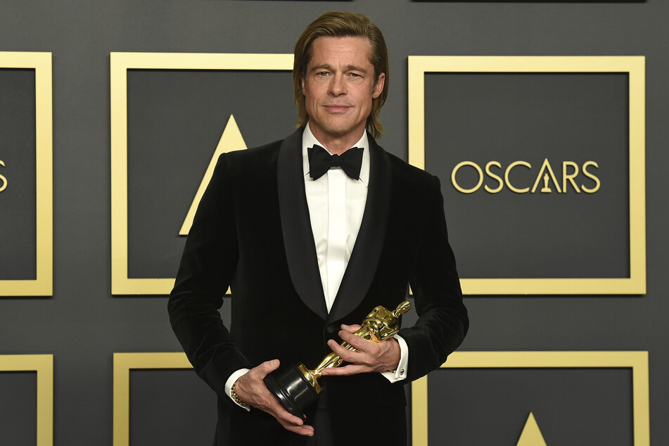Brad Pitt (56) holds the Oscar for best supporting actor at the 92nd Academy Awards ceremony in the Dolby Theatre.