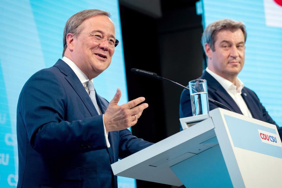 Union stellt Wahlprogramm vor: Kuscheln sich Laschet und Söder so zum Sieg?