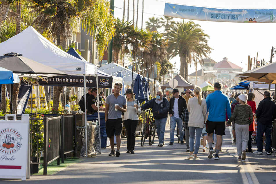 As Surf City Nights in Huntington Beach is already open for business, California's state representatives are discussing a full re-opening of its economy.