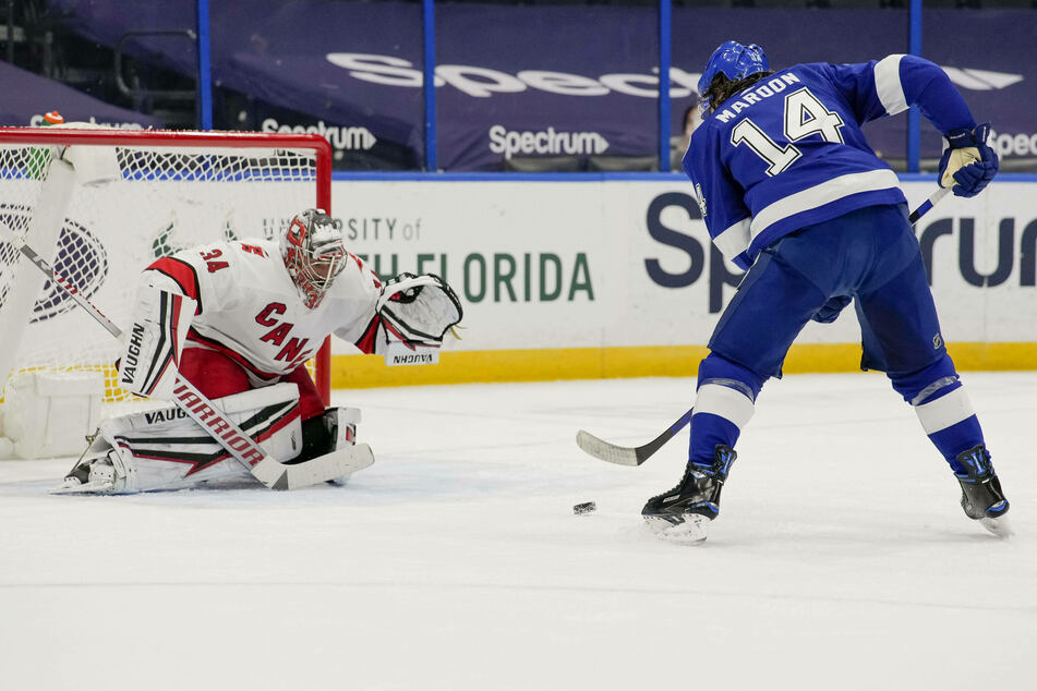 NHL: Lightning strikes in overtime as Tampa tries to keep up with Carolina in the Central Division