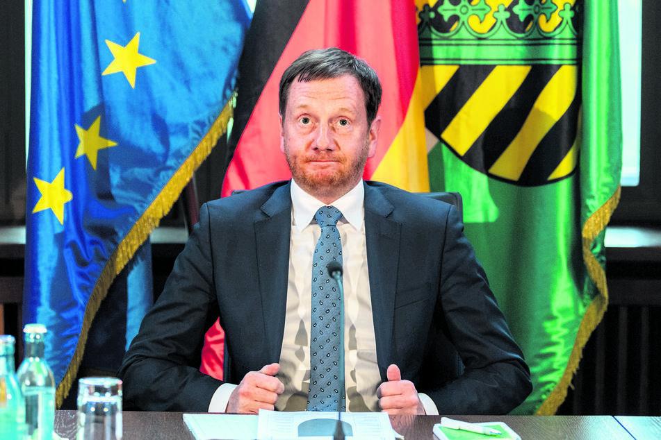 Ministerpräsident Michael Kretschmer stemmt sich gegen eine mögliche Verlängerung der zeitweiligen Steuersenkung.