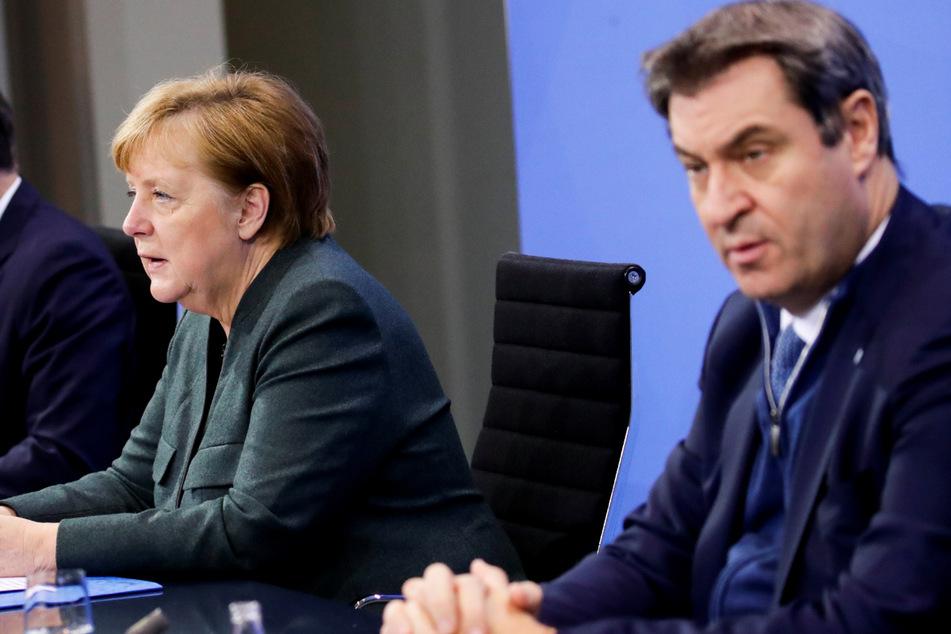 Merkel und Söder halten Konferenz mit allen bayerischen Landräten und OBs