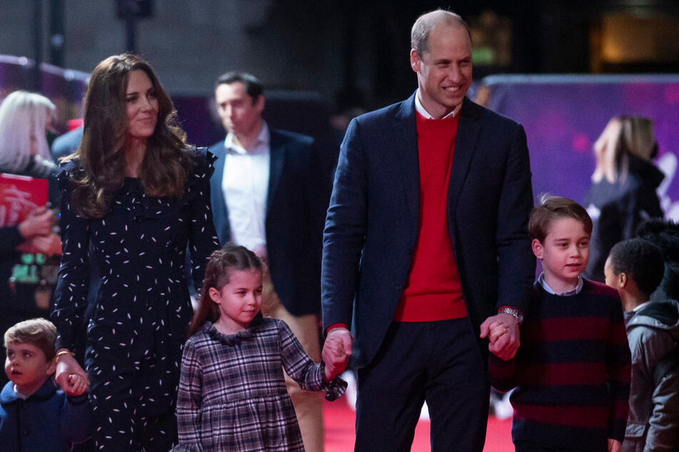 From l. to r.: Prince Louis, Duchess Kate, Princess Charlotte, Prince William, and Prince George arrive to attend a special pantomime performance at London's Palladium Theater.