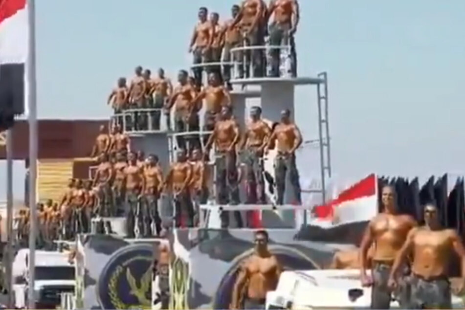 Egyptian police academy features bizarre parade of flexing shirtless men