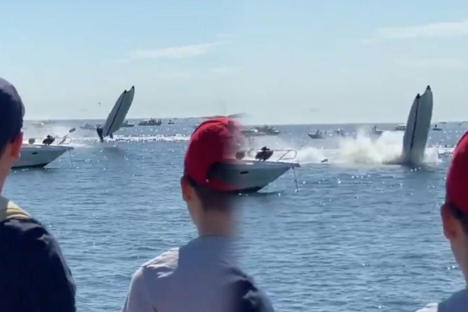 Eine Zuschauerin filmte das Unglück. Das Rennboot fliegt nach der Kollision kurz durch die Luft (l).