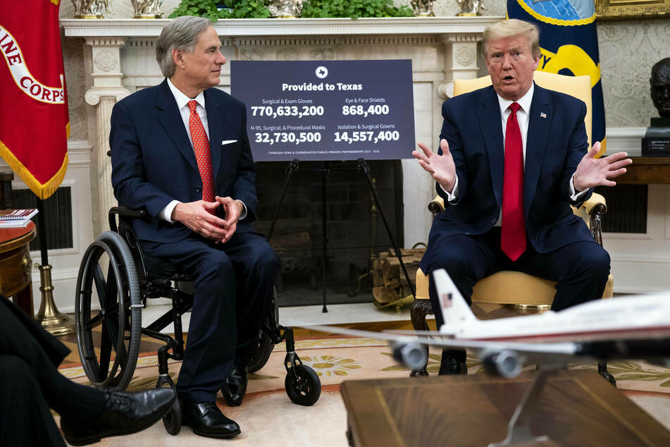 Donald Trump (r.) formally endorsed Greg Abbott's reelection campaign on Tuesday.