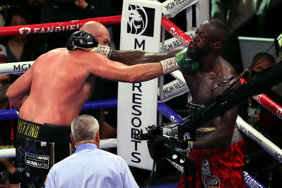 Third time's a charm: Tyson Fury knocks out Deontay Wilder to settle boxing rivalry trilogy