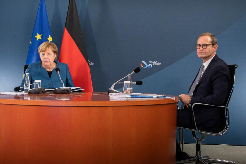 Bundeskanzlerin Angela Merkel (66, CDU) und der Regierende Bürgermeister von Berlin, Michael Müller (55, SPD).