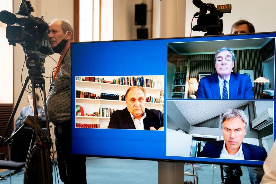 ZDH-Präsident Hans-Peter Wollseifer (l), BDA-Präsident Ingo Kramer (oben rechts) und Bitkom-Präsident Achim Berg (unten links) sind während einer Pressekonferenz per Videoschalte im Bundeswirtschaftsministerium auf einem Monitor zu sehen.