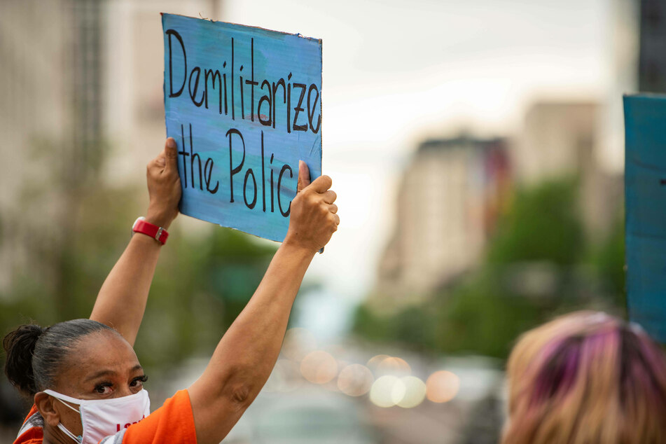 "The demand to ""defund the police"" calls for reduced police budgets and increased allocation of funds to social services."