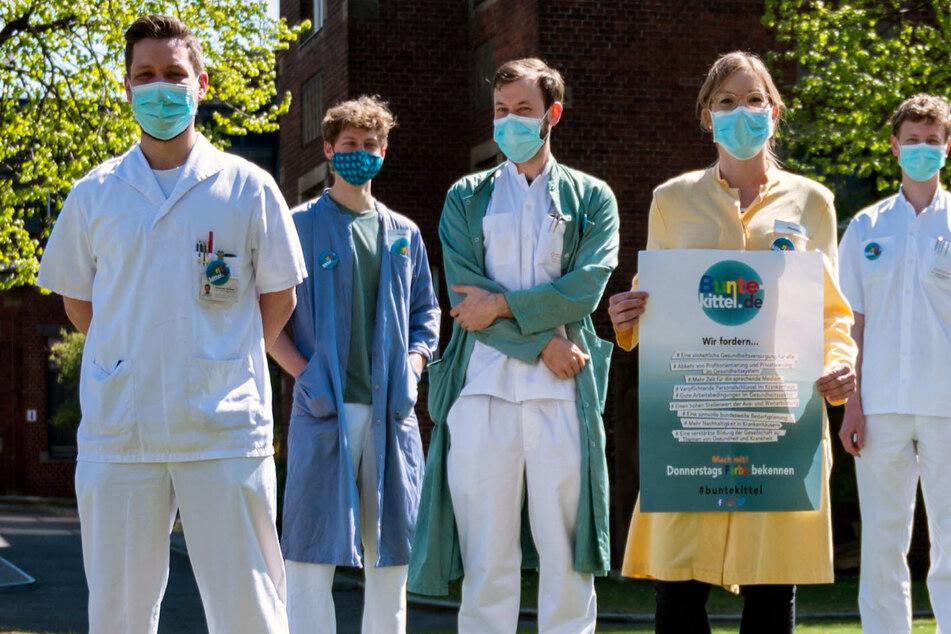 """Die Mediziner von """"Bunte Kittel"""" fordern ein gemeinwohlorientiertes Gesundheitssystem für Deutschland."""