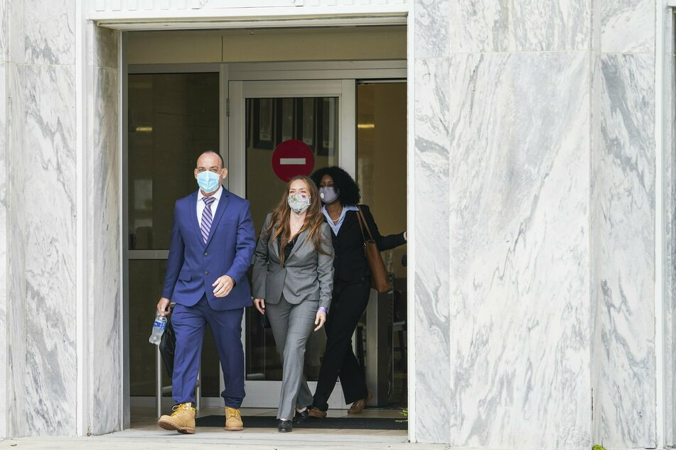 Lawyer Susan Friedman (2nd from left) leaves the public prosecutor's office together with her client Robert DuBoise (l.) after a hearing to exonerate DuBoise, who was acquitted after spending 37 years in prison.