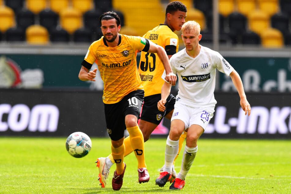 Marco Terrazzino (l.) traf für Dynamo Dresden auch am letzten Spieltag der vergangenen Saison gegen Osnabrück. Hier behauptet er sich gegen VfL-Mittelfeldkämpfer Bryan Henning (r.).