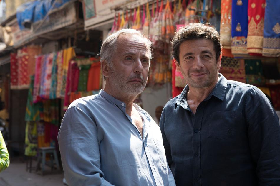 Arthur (l., Fabrice Luchini) und Cesar (Patrick Bruel) verschlägt es auch nach Indien.