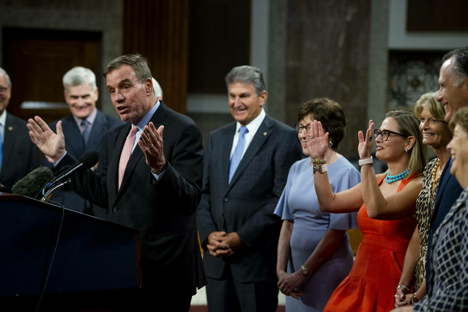 Virginia Senator Mark Warner makes remarks after the successful vote to proceed with debate on the bipartisan infrastructure plan.
