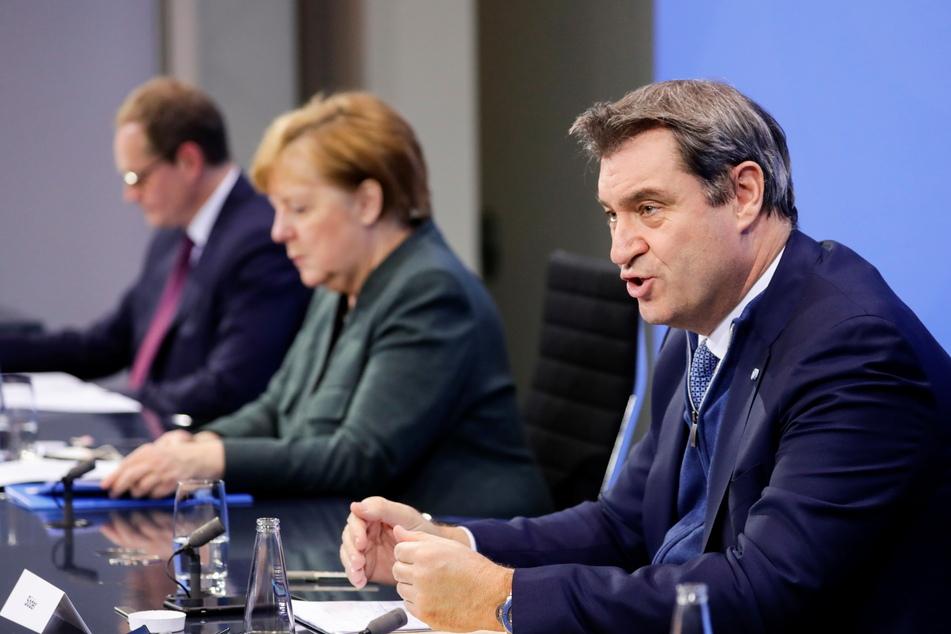Markus Söder (CSU, r.) hat die erneute Verlängerung des Lockdowns samt Schulschließungen verteidigt.