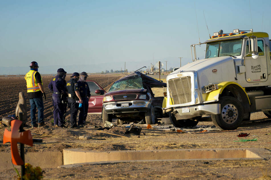 A man has been charged with smuggling in a deadly crash that killed 13 people.