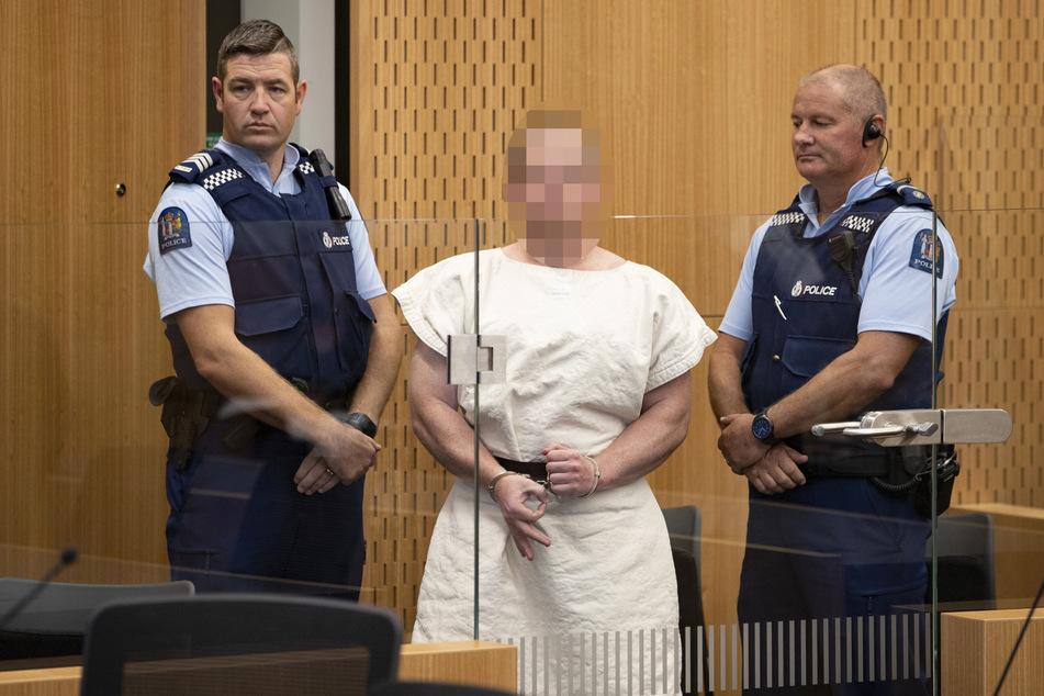 """16. März 2019, Christchurch: Der australische Täter (M) formt im Bezirksgericht vor einer Anhörung ein """"Okay""""-Zeichen mit seinen Fingern."""