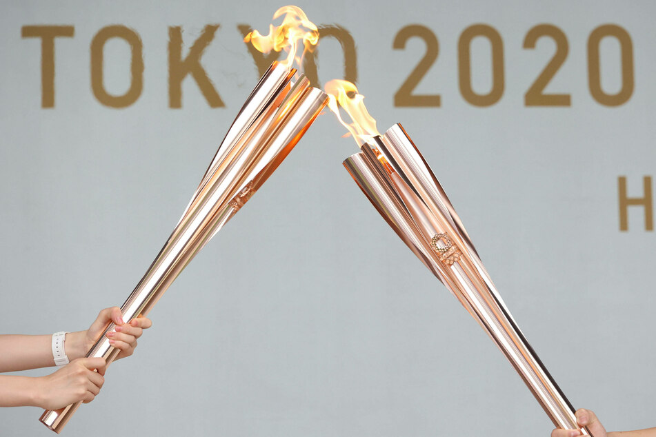 Muted reception as Olympic torch relay reaches Tokyo