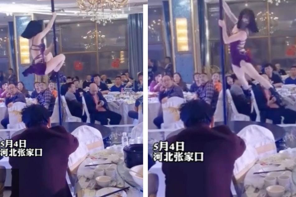 An entertainer performs a strip dance at a wedding reception in Zhangjiakou.