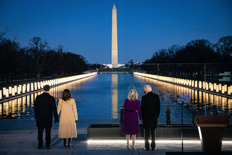 President-elect Joe Biden, from right, wife Jill Biden, Vice President-elect Kamala Harris, and husband Douglas Emhoff standing at the Lincoln Memorial Reflecting Pool.