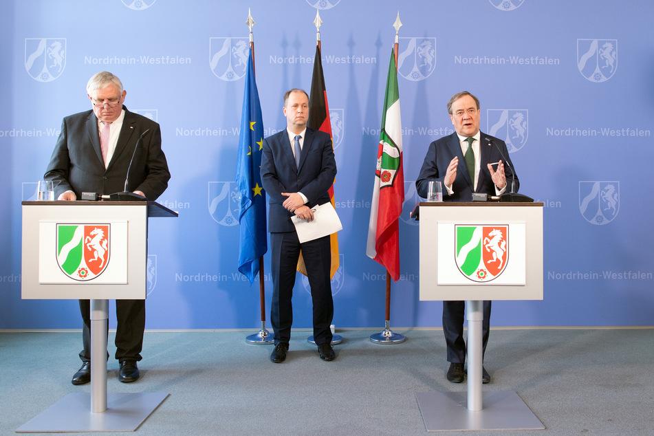 NRW-Gesundheitsminister Karl-Josef Laumann (CDU), NRW-Familienminister Joachim Stamp (FDP) und NRW-Ministerpräsident Armin Laschet (CDU).