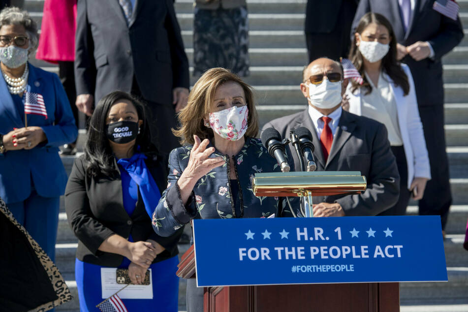 Speaker of the House Nancy Pelosi is joined by House Democrats for a press conference regarding the For the People Act of 2021.