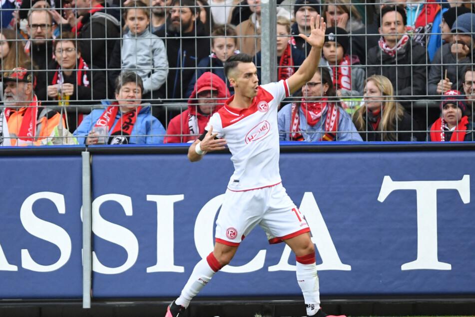 Freiburg: Fußball: Bundesliga, SC Freiburg - Fortuna Düsseldorf, 23. Spieltag im Schwarzwaldstadion. Erik Thommy von Düsseldorf bejubelt das 2:0.