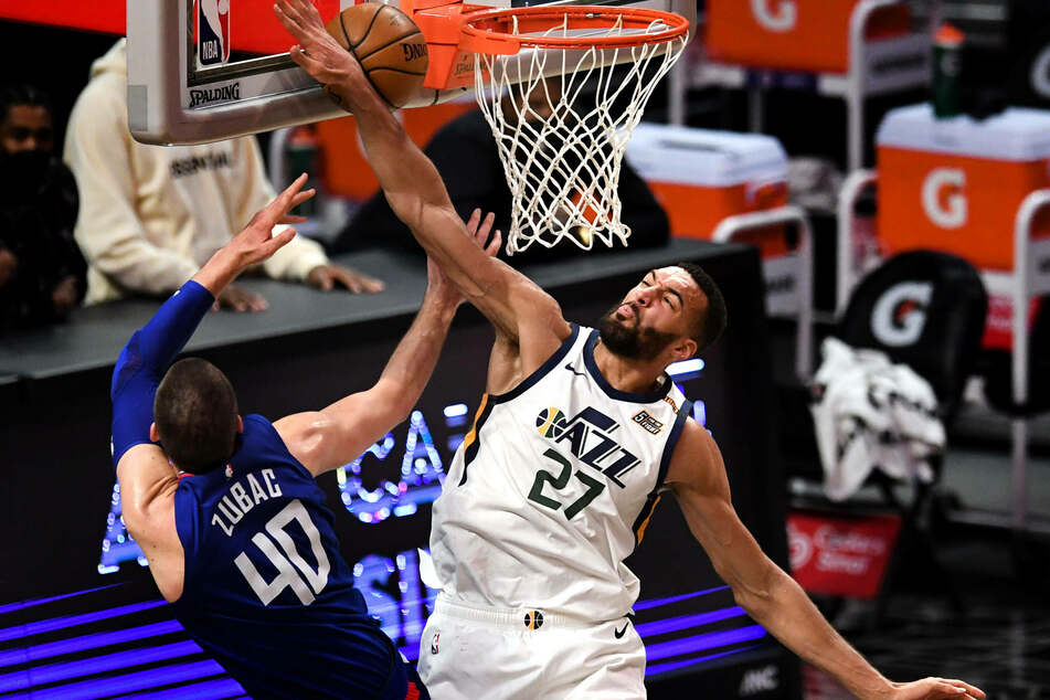 Jazz center Rudy Gobert is the 2021 NBA Defensive Player of the Year, his third award in four years.