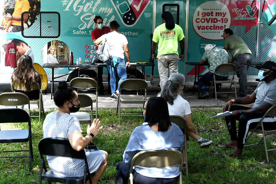 People getting the shot at a mobile vaccination center in Orlando, Florida.