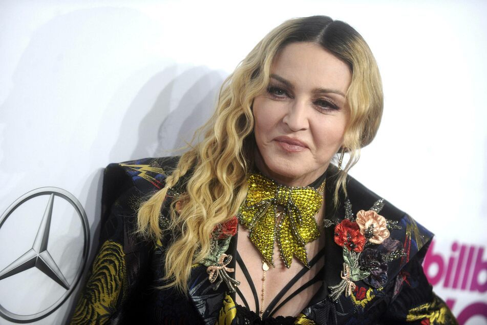 """The """"very first time"""" at 62: Madonna gets a tattoo!"""