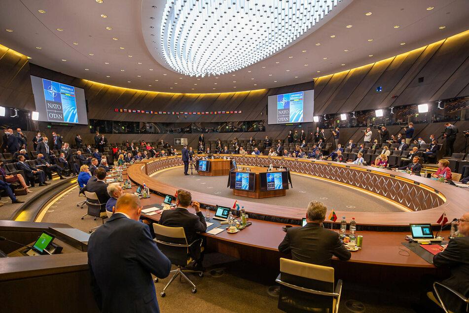 "NATO hardens stance on ""authoritarian"" China at Biden's first summit"