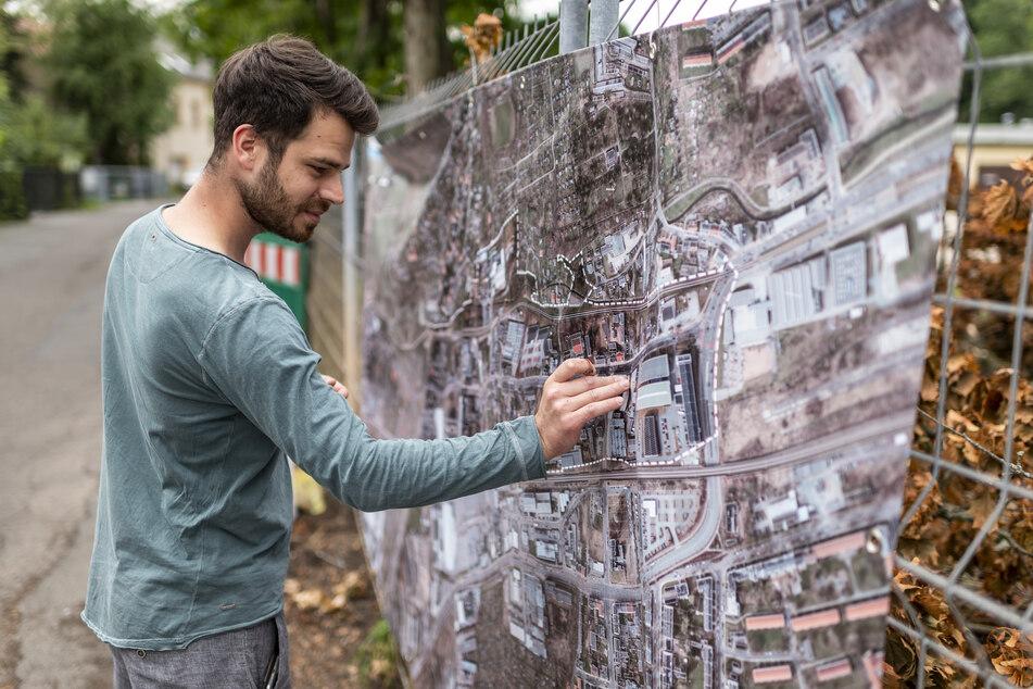 Fahrradfahrer Philipp Löschau (32) markiert beim Bürgerdialog mit einem roten Punkt eine gefährliche Stelle auf einem Plan der Zwickauer Straße.