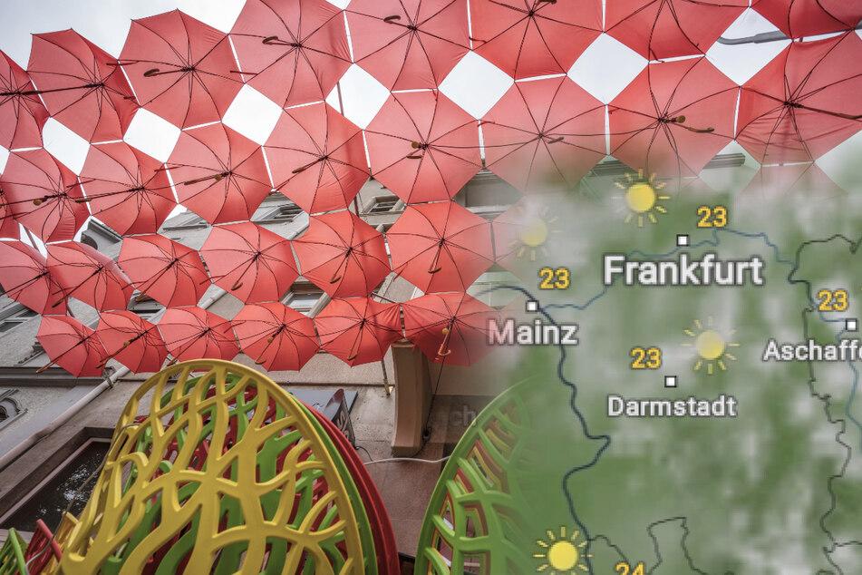 Rote Regenschirme sind auf der Außenterrasse eines italienischen Lokals am Alleenring in Frankfurt aufgestellt.