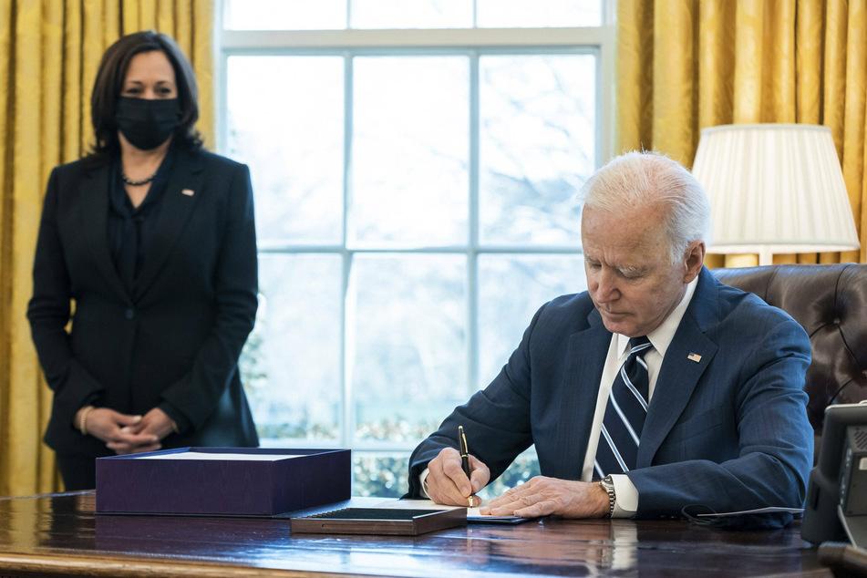 Biden signs historic stimulus bill on anniversary of pandemic declaration